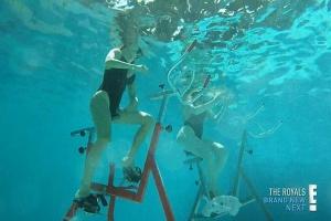 Khloe and Kourtney aqua bike during a water aerobics class in St. Bart's