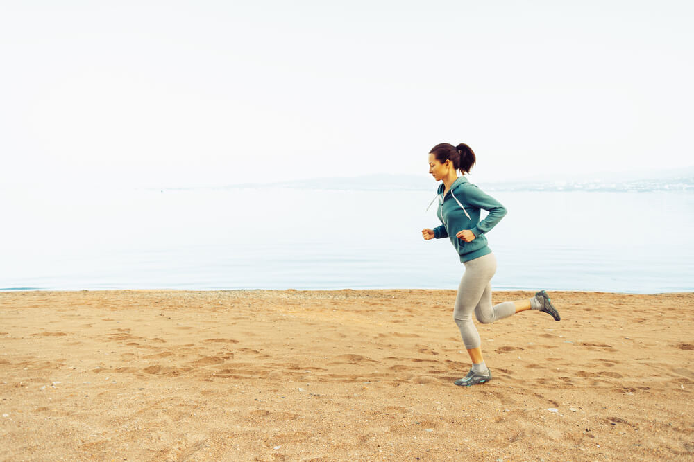 Keep things tight with a run in the sand! This adds resistance to your workout.